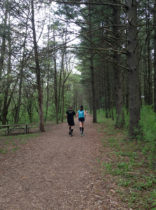 Two runners on trail